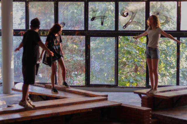 Three volunteers exploring an old building