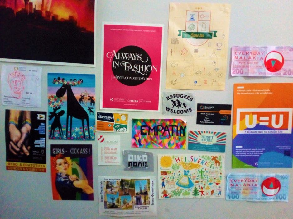 Image of different flyers and postcards on a wall