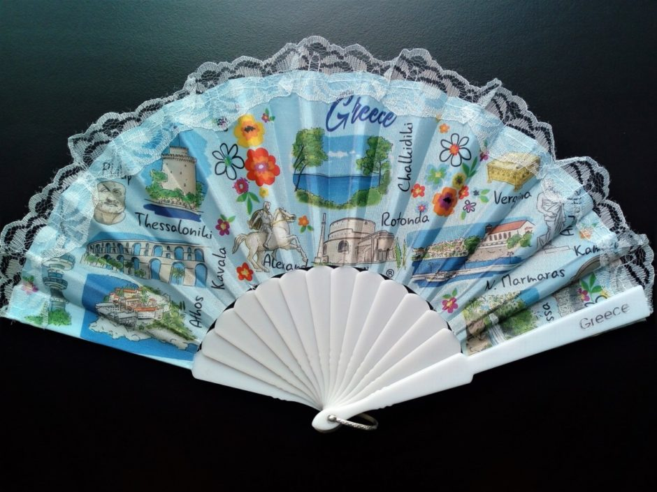 Image of a fan with pictures of well known places in Greece on it
